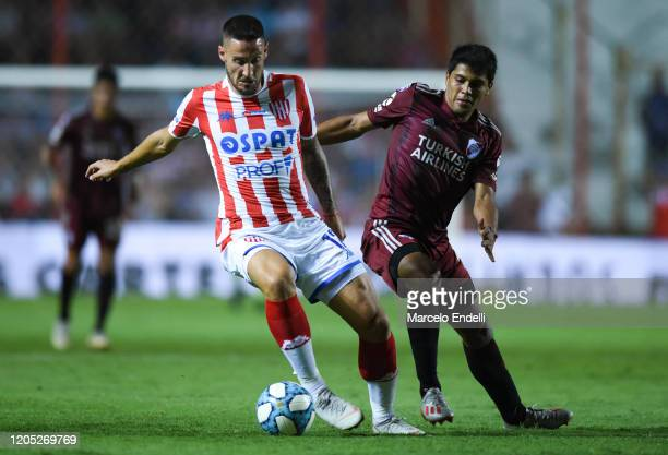 Nicolas Mazzola of Union fights for the ball with Robert Rojas of River Plate during a match between Union and River Plate as part of Superliga...