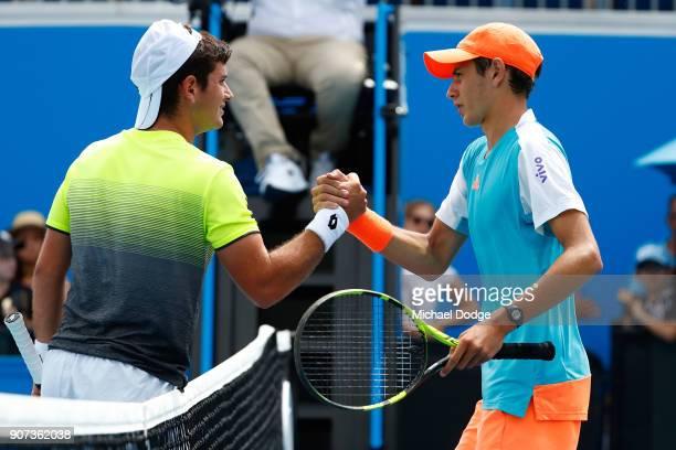 Nicolas Mejia of Colombia congratulates Matheus Pucinelli De Almeida of Brazil after Pucinelli De Almeida won their Australian Open 2018 Junior...