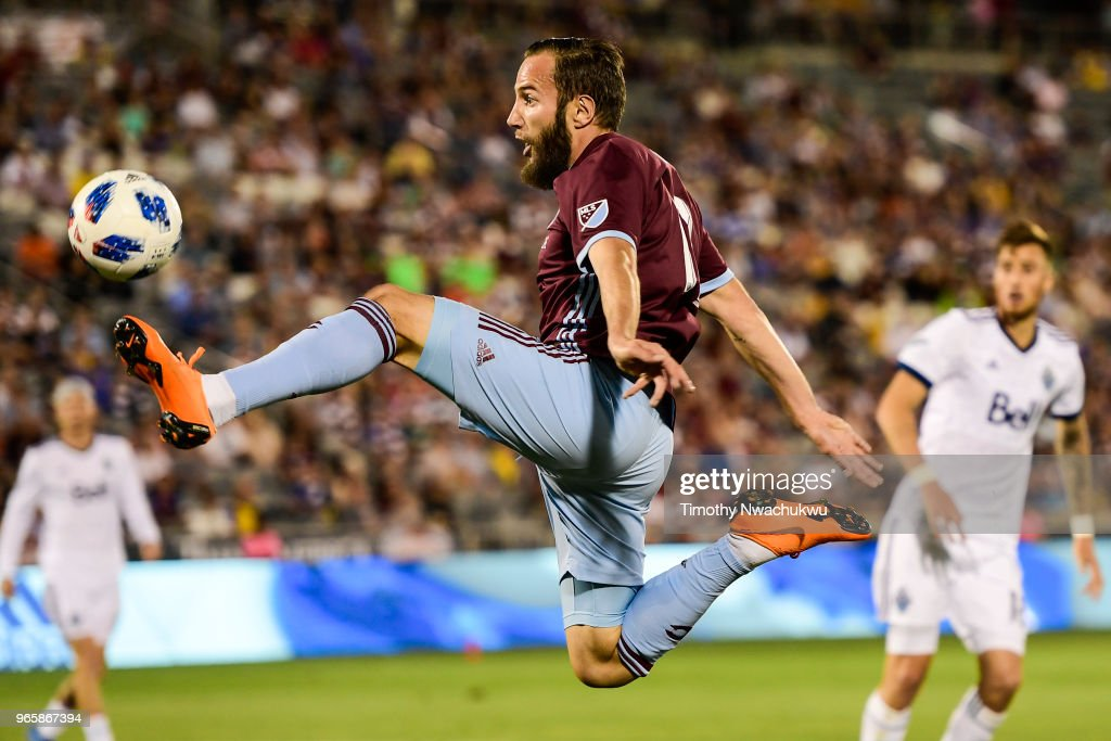 Nicolas Mezquida #11 of Vancouver Whitecaps reaches for the ball against the Colorado Rapids at Dick's Sporting Goods Park on June 1, 2018 in Commerce City, Colorado.