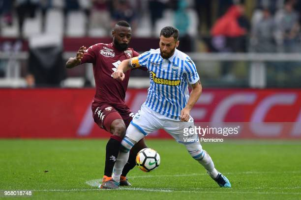 Nicolas N koulou of Torino FC competes with Alberto Grassi of Spal during the Serie A match between Torino FC and Spal at Stadio Olimpico di Torino...