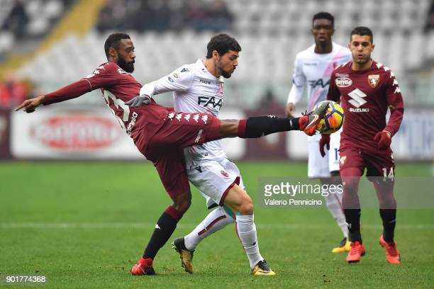 Nicolas N koulou of Torino FC competes with Mattia Destro of Bologna FC during the serie A match between Torino FC and Bologna FC at Stadio Olimpico...