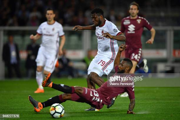 Nicolas N koulou of Torino FC is tackled by Franck Kessie of AC Milan during the Serie A match between Torino FC and AC Milan at Stadio Olimpico di...