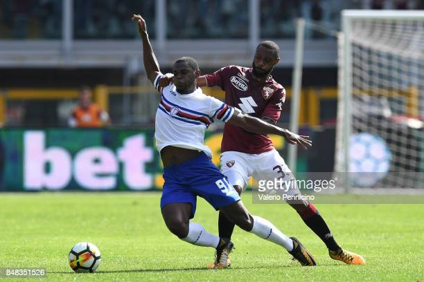Nicolas N koulou of Torino FC tackles Duvan Esteban Zapata of UC Sampdoria during the Serie A match between Torino FC and UC Sampdoria at Stadio...