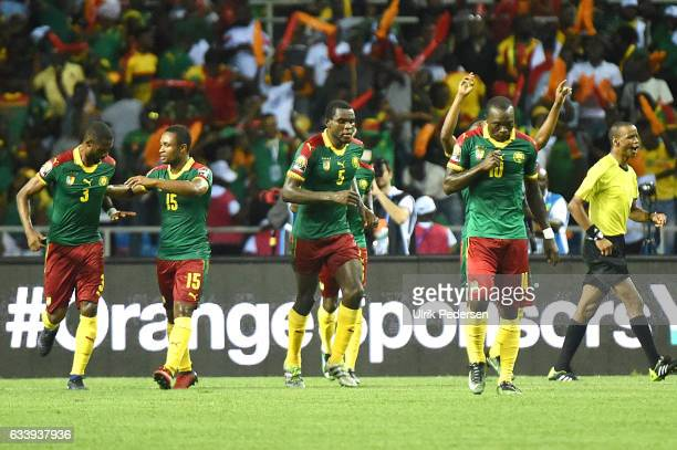 Nicolas Nkoulou celebrates his goal to make 11 during the African Nations Cup Final match between Cameroon and Egypt at Stade de L'Amitie on February...