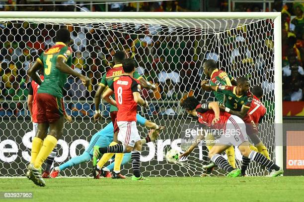 Nicolas Nkoulou of Cameroon scores to make 11 during the African Nations Cup Final match between Cameroon and Egypt at Stade de L'Amitie on February...