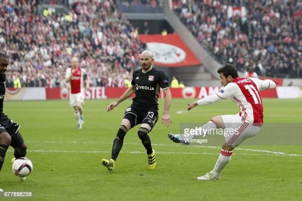 Nicolas Nkoulou of Olympique Lyonnais Nicolas Nkoulou of Olympique Lyonnais Amin Younes of Ajax 30during the UEFA Europa League semi final match...