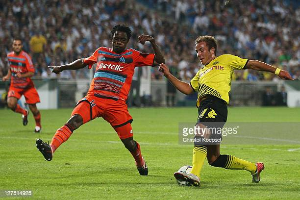 Nicolas Nkoulou of Olympique Marseille challenges Mario Goetze of Dortmund during the UEFA Champions League group F match between Olympique Marseille...