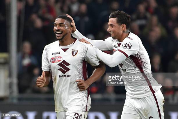 Nicolas Nkoulou of Torino FC celebrates after his first goal with Armando Izzo during the Serie A match between Genoa CFC and Torino FC at Stadio...