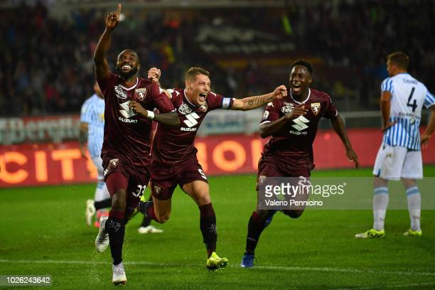 Nicolas Nkoulou of Torino FC celebrates after scoring the opening goal with team mates Andrea Belotti and Soualiho Meite during the Serie A match...