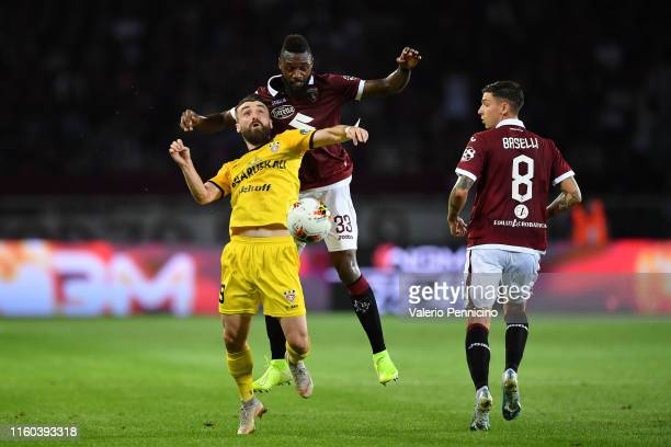 Nicolas Nkoulou of Torino FC clashes with Elis Bakaj of FC Shakhtyor during the UEFA Europa League Third Qualifying Round First Leg fixture between...