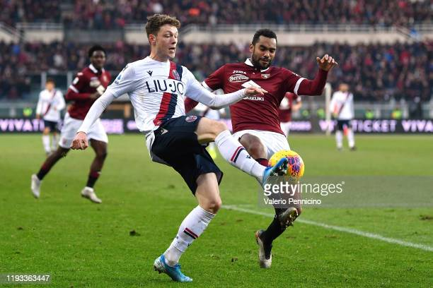 Nicolas Nkoulou of Torino FC competes with Andreas Skov Olsen of Bologna FC during the Serie A match between Torino FC and Bologna FC at Stadio...