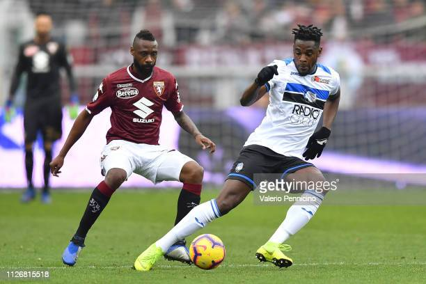 Nicolas Nkoulou of Torino FC competes with Duvan Zapata of Atalanta BC during the Serie A match between Torino FC and Atalanta BC at Stadio Olimpico...