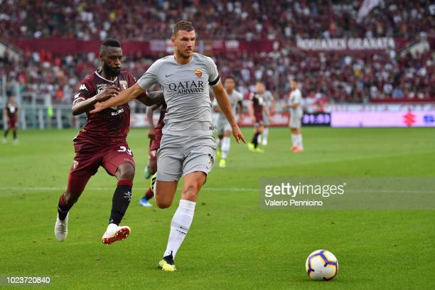 Nicolas Nkoulou of Torino FC competes with Edin Dzeko of AS Roma during the Serie A match between Torino FC and AS Roma at Stadio Olimpico di Torino...