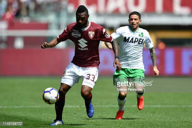 Nicolas Nkoulou of Torino FC in action against Stefano Sensi of US Sassuolo during the Serie A match between Torino FC and US Sassuolo at Stadio...