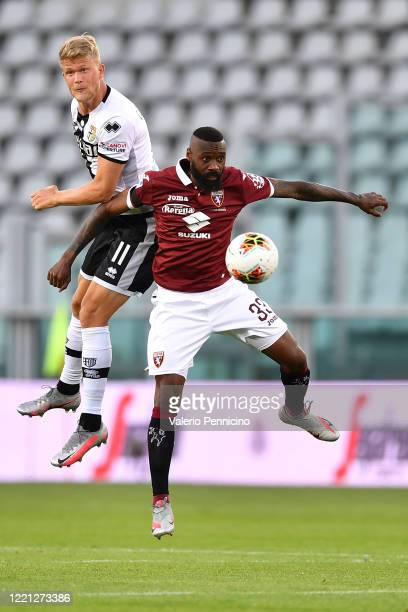 Nicolas Nkoulou of Torino FC jumps for the ball against Andreas Cornelius of Parma Calcio during the Serie A match between Torino FC and Parma Calcio...
