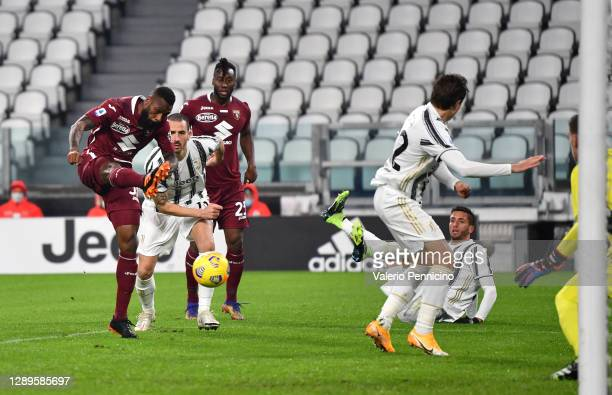 Nicolas Nkoulou of Torino FC scores his team's first goal during the Serie A match between Juventus and Torino FC at Allianz Stadium on December 05,...