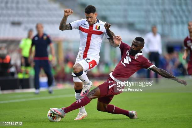 Nicolas Nkoulou of Torino FC tackles Andrea Pinamonti of Genoa CFC during the Serie A match between Torino FC and Genoa CFC at Stadio Olimpico di...