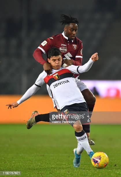 Nicolas Nkoulou of Torino FC tackles Kevin Agudello of Genoa CFC during the Coppa Italia match between Torino FC and Genoa CFC at Stadio Olimpico...