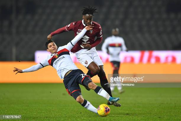 Nicolas Nkoulou of Torino FC tackles Kevin Agudello of Genoa CFC during the Coppa Italia match between Torino FC and Genoa CFC at Stadio Olimpico...