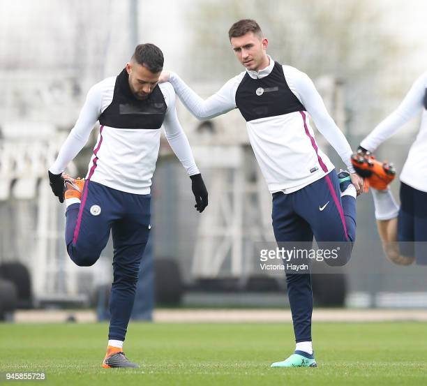 Nicolas Otamendi and Aymeric Laporte stretch during a training session at Manchester City Football Academy on April 13 2018 in Manchester England