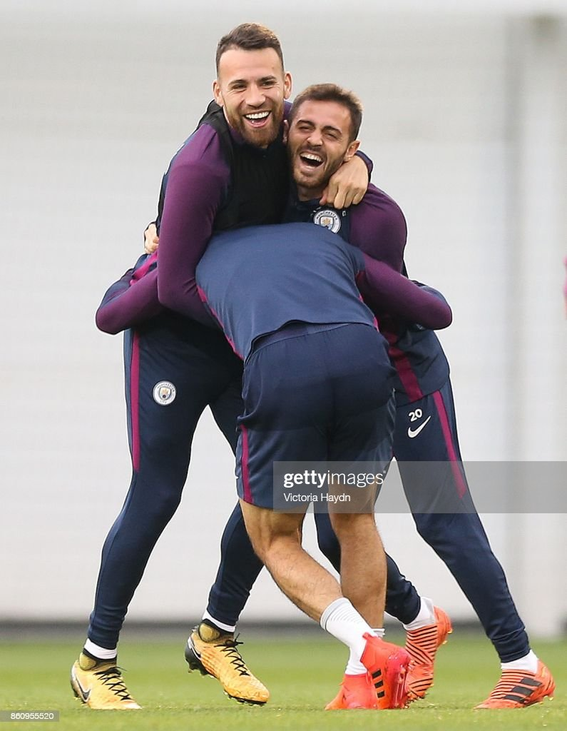 Nicolas Otamendi and Bernardo Silva joke with Leroy Sane at Manchester City Football Academy on October 13, 2017 in Manchester, England.