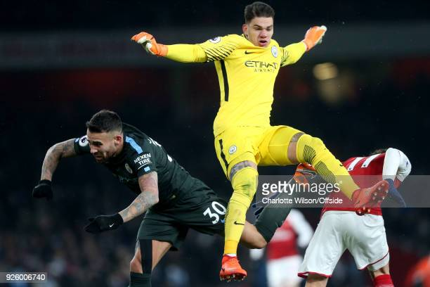 Nicolas Otamendi and Emerson of Manchester City in action with Mesut Ozil of Arsenal during the Premier League match between Arsenal and Manchester...