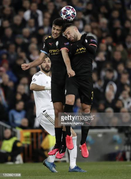 Nicolas Otamendi and Rodri of Manchester City in action during the UEFA Champions League round of 16 first leg soccer match between Real Madrid and...