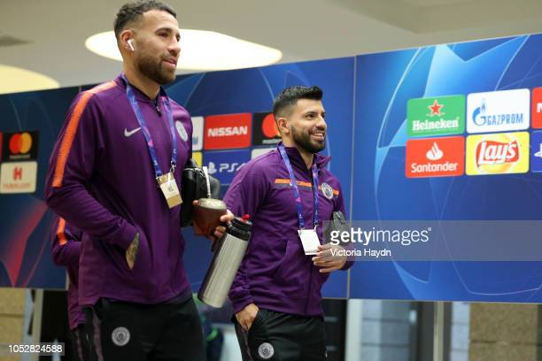Nicolas Otamendi and Sergio Aguero of Manchester City arrive prior to the Group F match of the UEFA Champions League between FC Shakhtar Donetsk and...