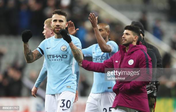 Nicolas Otamendi and Sergio Aguero of Manchester City celebrate victory after the Premier League match between Newcastle United and Manchester City...