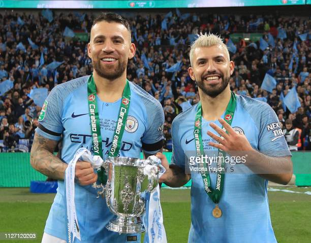 Nicolas Otamendi and Sergio Aguero of Manchester City celebrate victory with the trophy after the Carabao Cup Final between Chelsea and Manchester...