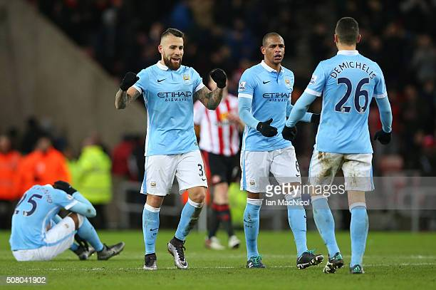 Nicolas Otamendi Fernando and Martin Demichelis of Manchester City celebrate their 10 win after the Barclays Premier League match between Sunderland...