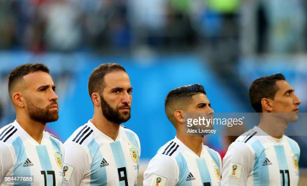 Nicolas Otamendi Gonzalo Higuain Ever Banega and Angel Di Maria of Argentina line up prior to the 2018 FIFA World Cup Russia group D match between...