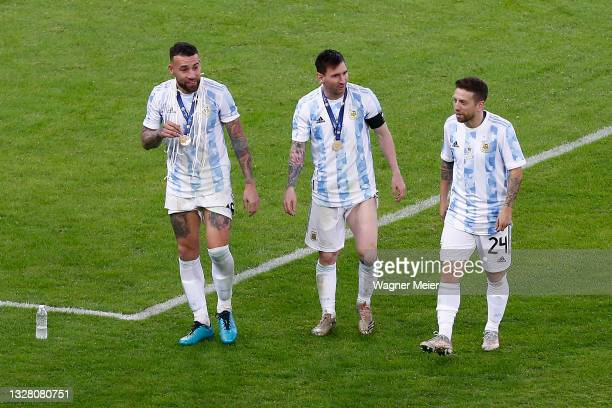 Nicolas Otamendi, Lionel Messi and Alejandro Gomez of Argentina celebrate with their medals after winning the final of Copa America Brazil 2021...