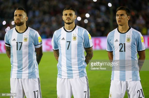 Nicolas Otamendi Mauro Icardi and Paulo Dybala of Argentina line up for the National Anthem prior to a match between Uruguay and Argentina as part of...