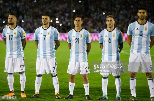 Nicolas Otamendi Mauro Icardi Paulo Dybala Lucas Biglia and Federico Fazio of Argentina line up for the National Anthem prior to a match between...