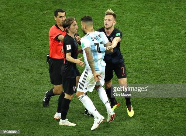 Nicolas Otamendi of Argentina argues with Luka Modric and Ivan Rakitic of Croatia during the 2018 FIFA World Cup Russia group D match between...