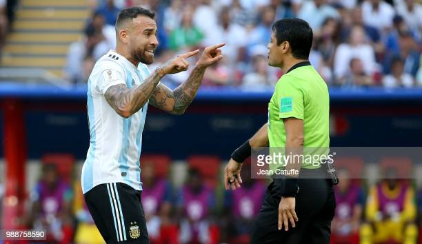 Nicolas Otamendi of Argentina argues with referee Alireza Faghani of Iran during the 2018 FIFA World Cup Russia Round of 16 match between France and...