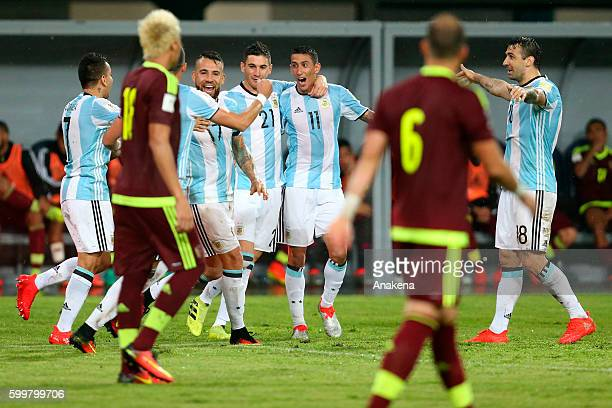 Nicolas Otamendi of Argentina celebrates with his teammates after scoring the tying goal during a match between Venezuela and Argentina as part of...