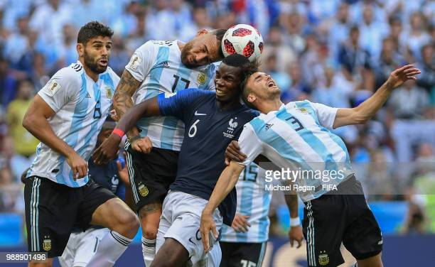 Nicolas Otamendi of Argentina competes for a header with Paul Pogba of France and Nicolas Tagliafico of Argentina during the 2018 FIFA World Cup...