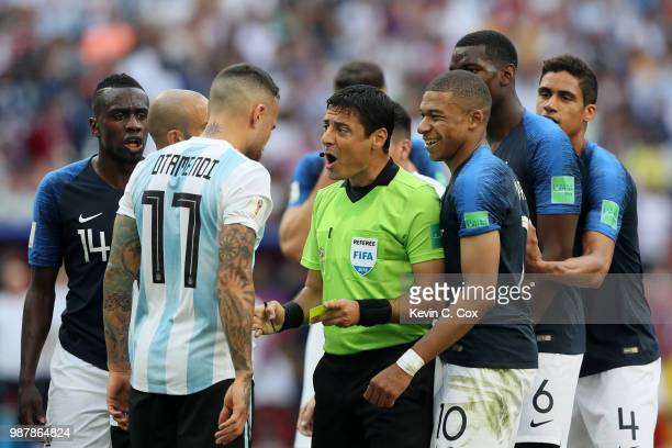 Nicolas Otamendi of Argentina confronts referee Alireza Faghani after he awards France a free kick during the 2018 FIFA World Cup Russia Round of 16...
