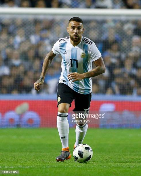 Nicolas Otamendi of Argentina drives the ball during an international friendly match between Argentina and Haiti at Alberto J Armando Stadium on May...