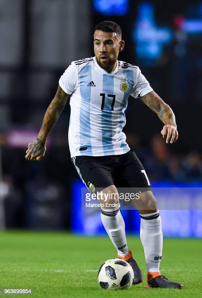 Nicolas Otamendi of Argentina drives the ball during an international friendly match between Argentina and Haiti at Alberto J Armando Stadium on May...