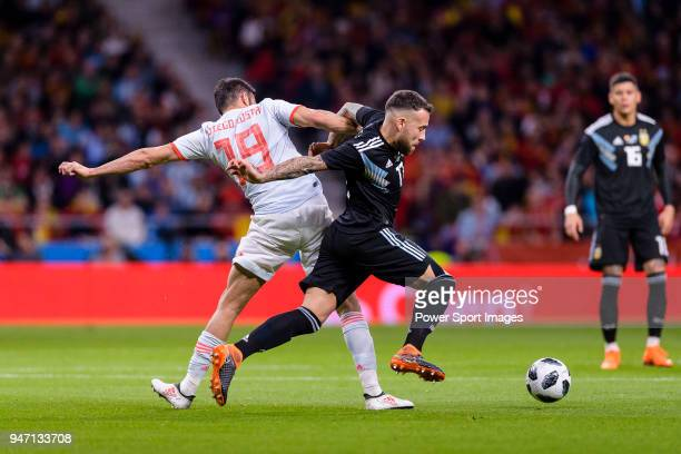 Nicolas Otamendi of Argentina fights for the ball with Diego Costa of Spain during the International Friendly 2018 match between Spain and Argentina...