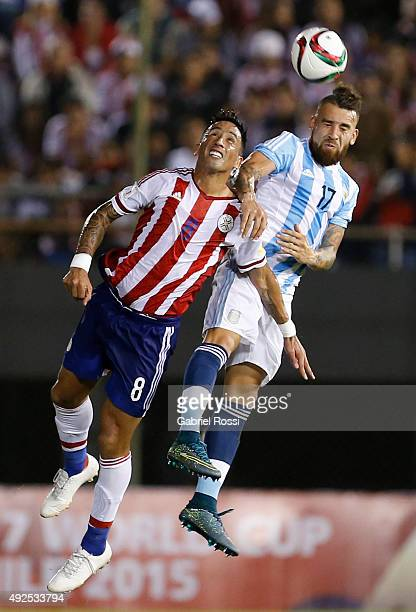 Nicol‡as Otamendi of Argentina fights for the ball with Lucas Barrios of Paraguay during a match between Paraguay and Argentina as part of FIFA 2018...