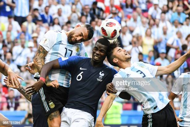 Nicolas Otamendi of Argentina Paul Pogba of France and Nicolas Tagliafico of Argentina during the FIFA World Cup Round of 16 match between France and...