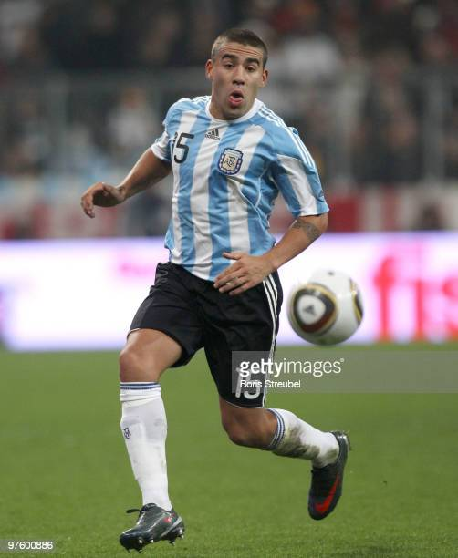 Nicolas Otamendi of Argentina runs with the ball during the International Friendly match between Germany and Argentina at the Allianz Arena on March...