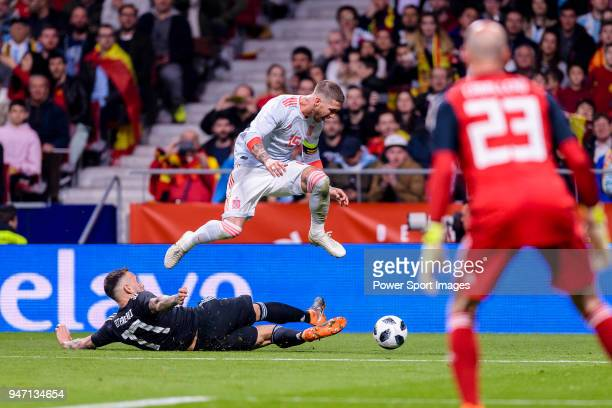 Nicolas Otamendi of Argentina trips up with Sergio Ramos of Spain during the International Friendly 2018 match between Spain and Argentina at Wanda...
