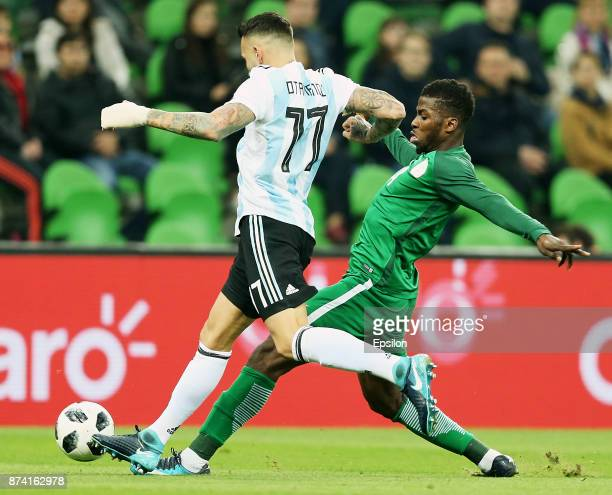 Nicolas Otamendi of Argentina vies for the ball with Kelechi Iheanacho of Nigeria during the International Friendly Match between Argentina and...