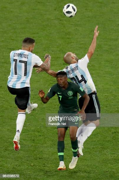 Nicolas Otamendi of Argentina wins a header ove Ahmed Musa of Nigeria during the 2018 FIFA World Cup Russia group D match between Nigeria and...