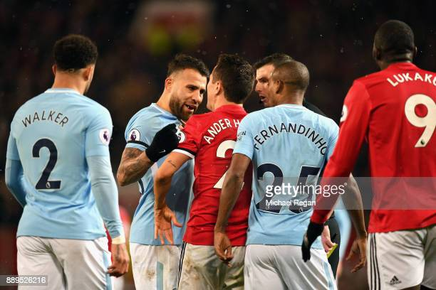 Nicolas Otamendi of Manchester City and Ander Herrera of Manchester United square up during the Premier League match between Manchester United and...